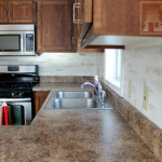 Paint your back splash to look like faux marble tile! This photo tutorial will show you how.