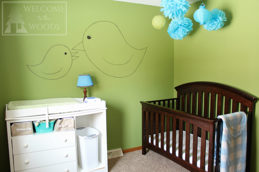 Nursery color scheme of blue & green with white & espresso furniture.