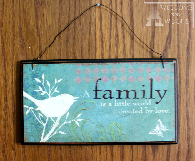 "Wall hanging for the nursery with cute quote, ""A Family is a little world created by love."""
