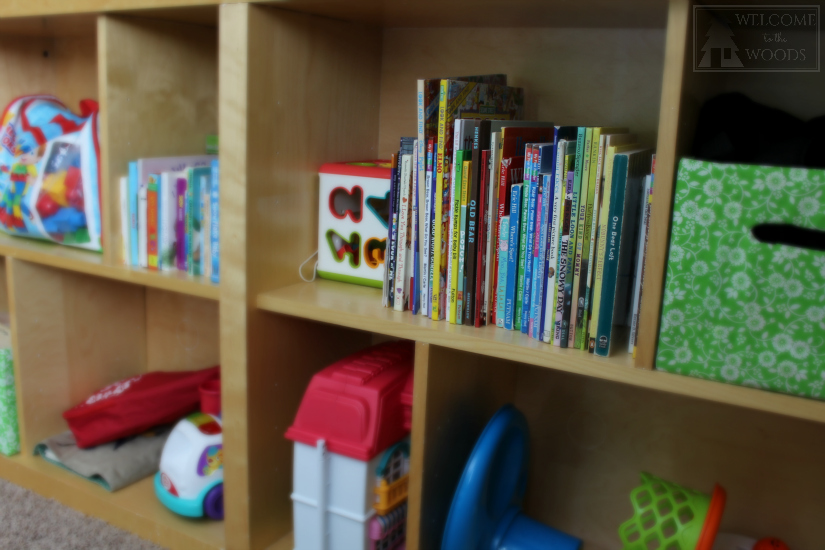 Tons of storage for books on IKEA bookshelves, all easily accessible to little kids!