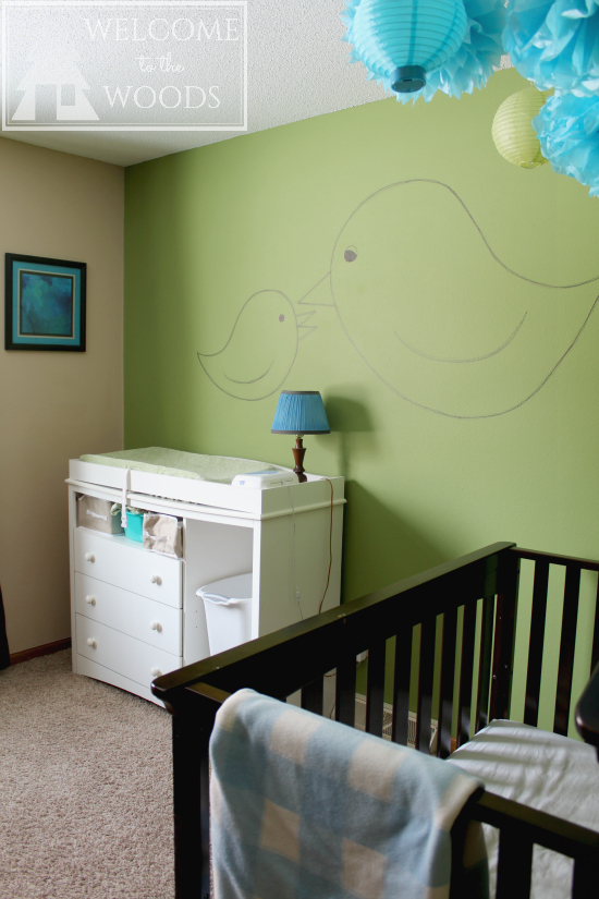Changing table and crib furniture arrangement in an adorable nursery design. Paint baby's room in green and then it works with a boy or a girl!