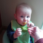 baby eating pureed solids