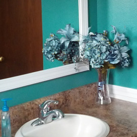 Teal bathroom white wainscoting reclaimed wood shelving