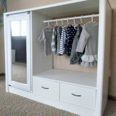 Turn an old entertainment center to closet with this incredible furniture makeover tutorial!