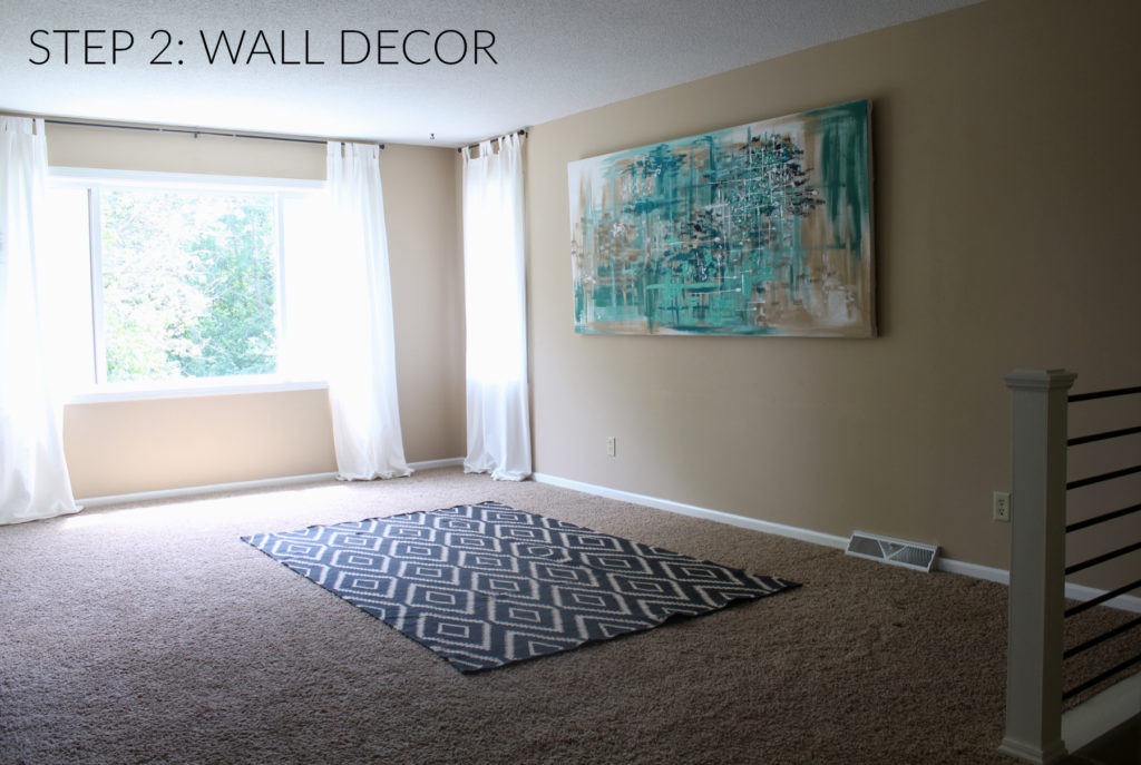 Step 2 in designing a home, is hanging wall art. One large piece of art can really make a statement or cover your large blank wall with a gallery arrangement.