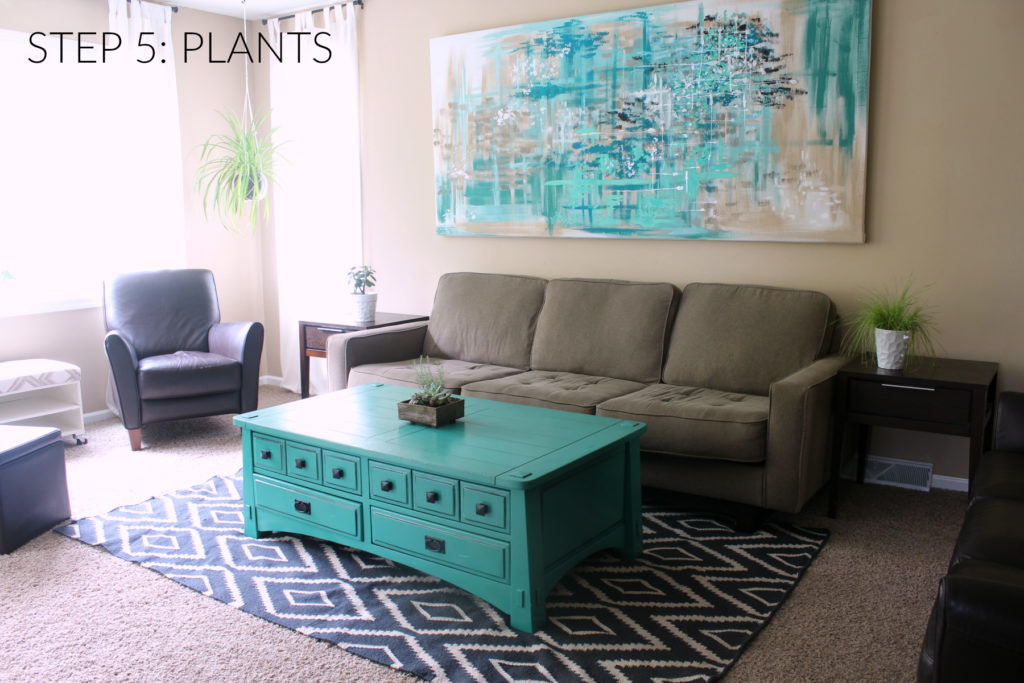 Step 5 in designing a room is adding plants to breath life into the space. The green is considered a neutral in design and is easy to pair with any color.