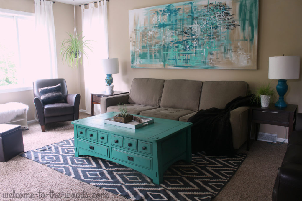 Step 6 in designing a room is to add accessories like lamps, throw pillows, decor and throws to add texture to the design.