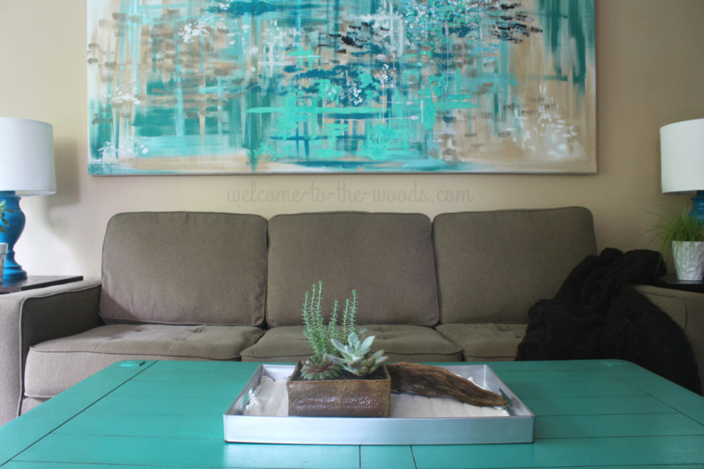 Pops of teal bring this living room design to life. See how the space was put together step by step.