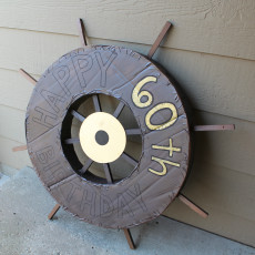 Awesome ship wheel constructed out of cardboard for a pirate ship! Learn how to make one as a party decoration.