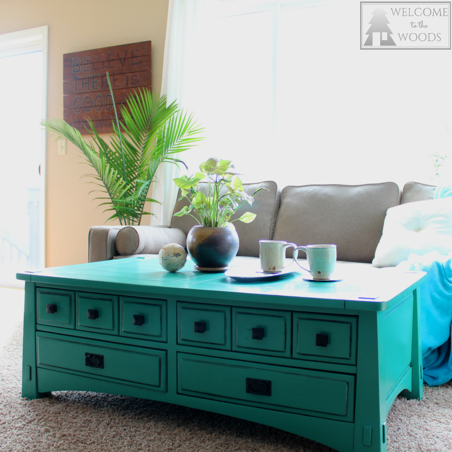 Bright teal turquoise coffee table provides a funky and modern focal point to this modern contemporary living room design.