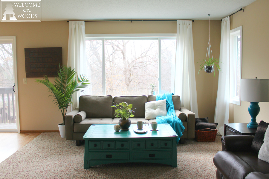 Decorating and designing a living room with lots of light and tons of windows.