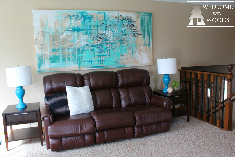 How to modernize and decorate your living room with a big ugly brown recliner couch. I hate this sofa, but I tried to work with it by adding this modern painting to detract from its outdated and mancave vibe.