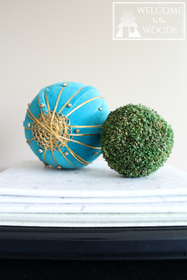 Spring home decor accessories moss ball and teal gold pin cushion.