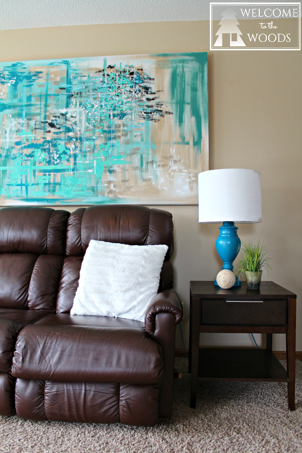 I love this giant piece of abstract artwork over the couch!