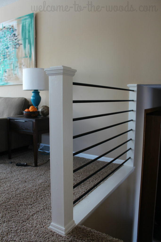 Beautiful modern and sleek stair railing design done by a young mommy blogger. You have to watch the video tutorial to see this amazing transformation!