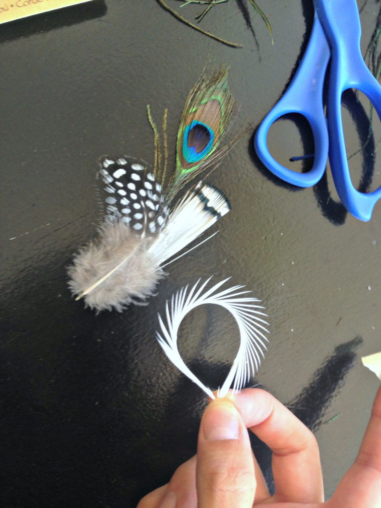 DIY tutorial for a handmade feather boutonniere for your wedding.