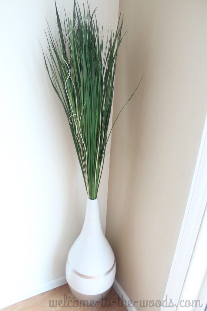Vase full of green grass reeds for summer