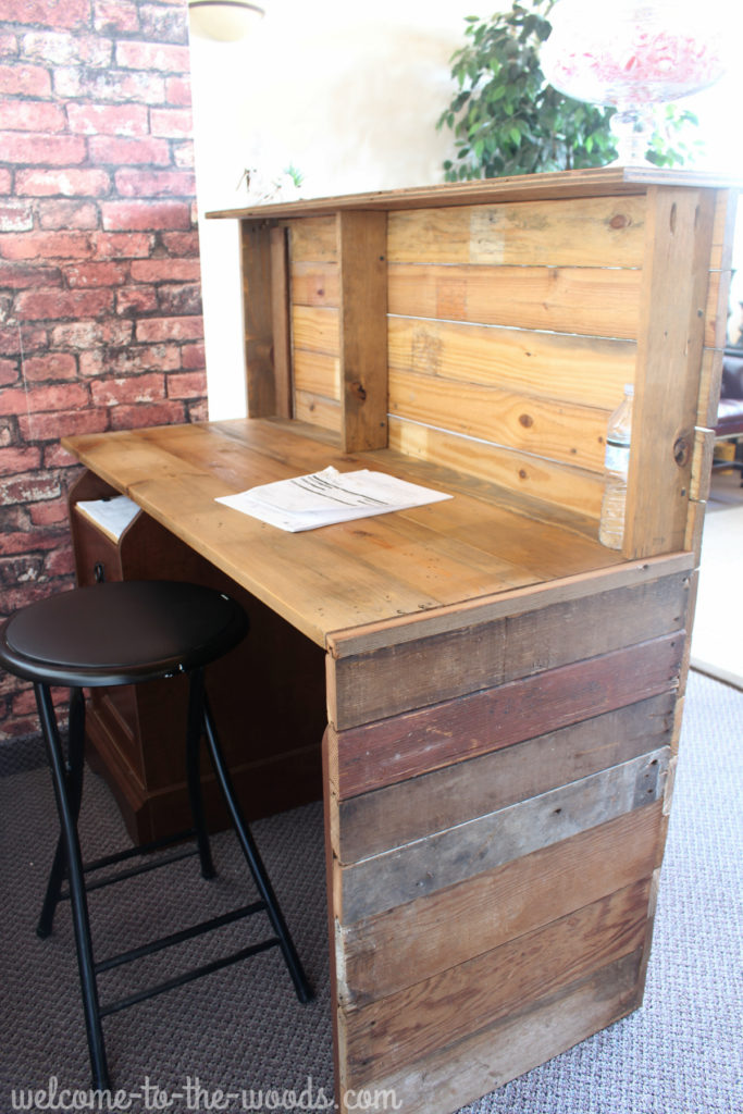 Reclaimed barn wood reception desk, created by revamping an existing piece of furniture.