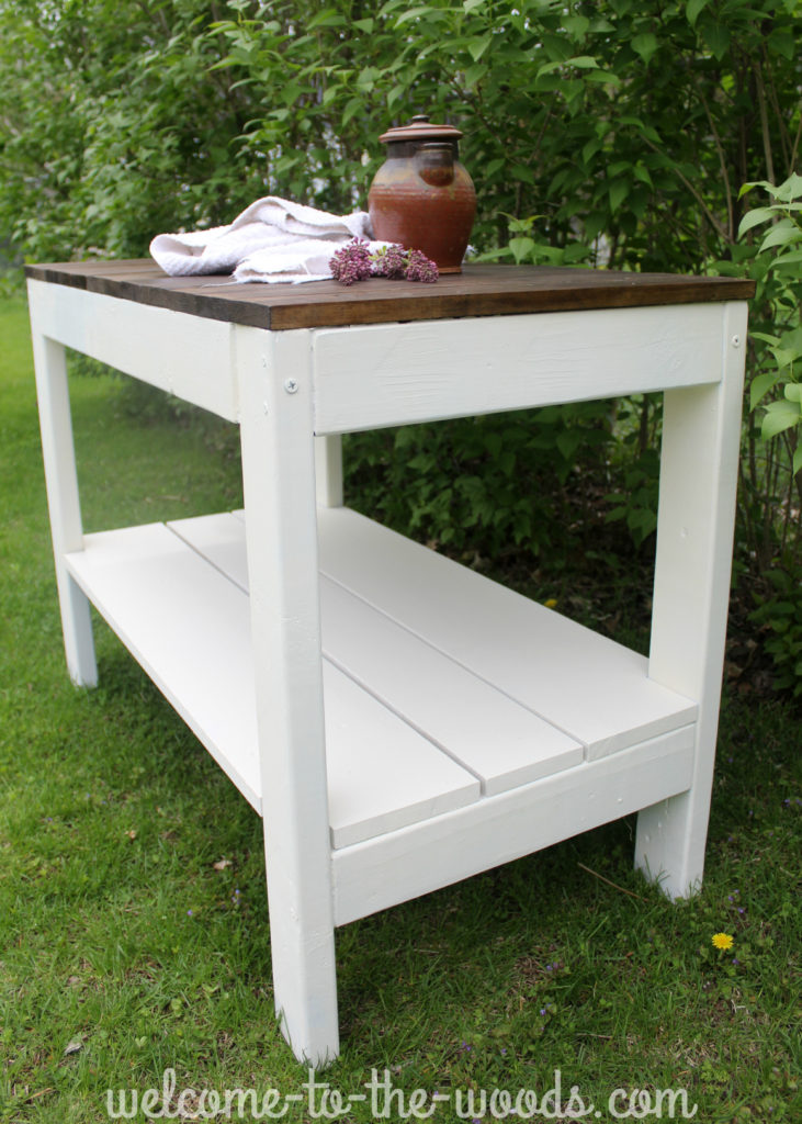 This farmhouse table was easy to build and the contrasting espresso stained wood with the white painted wood looks great!