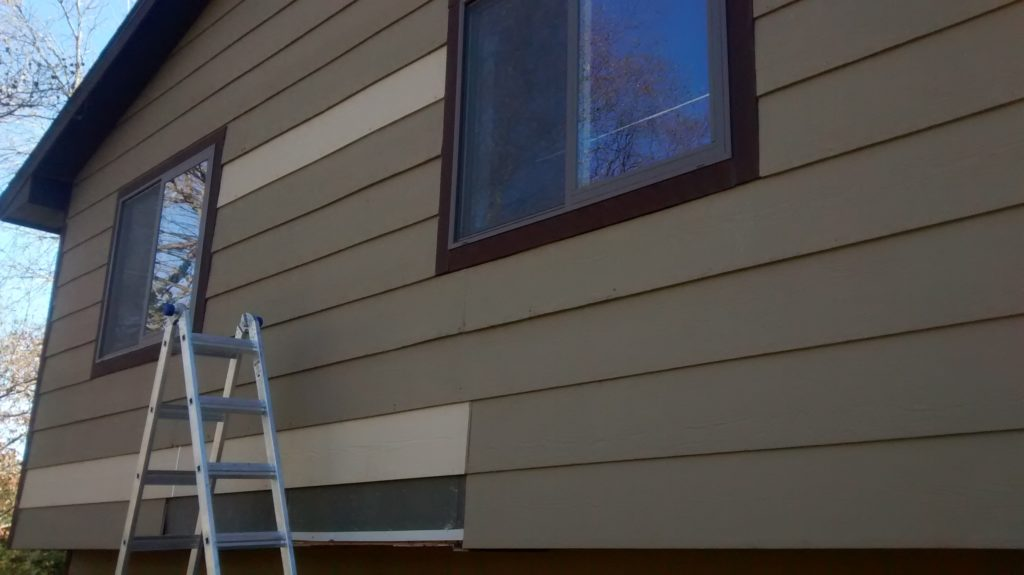 Ripping off old siding to replace rotten pieces