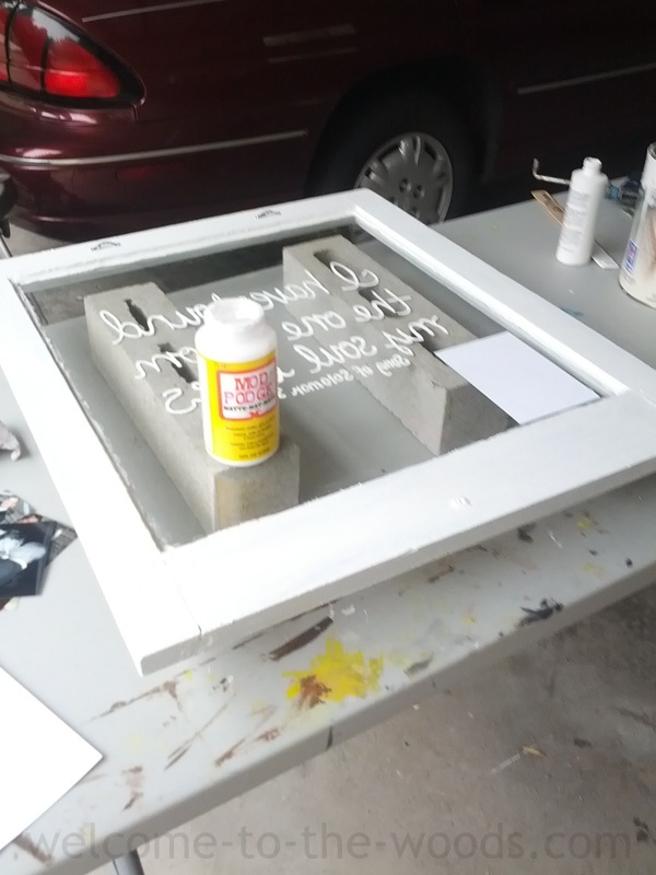 Attach photographs to glass with mod podge adhesive