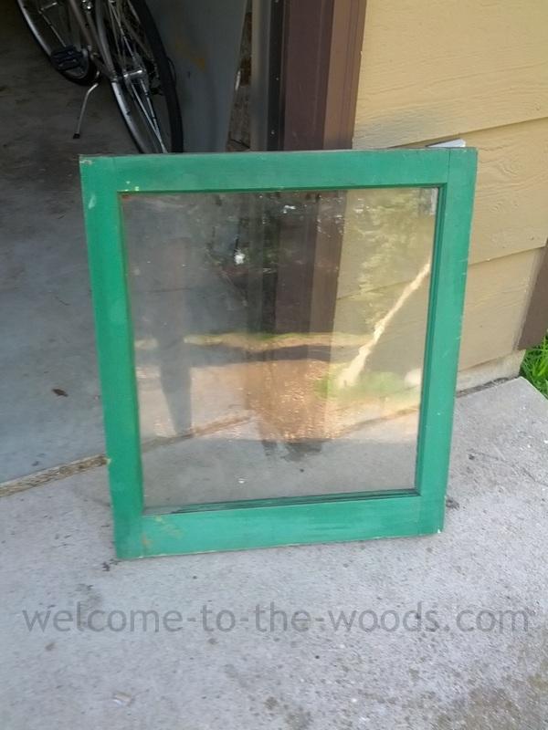 Old vintage window pane painted green