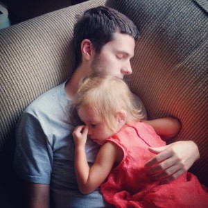 girl daughter sleeping on father dad