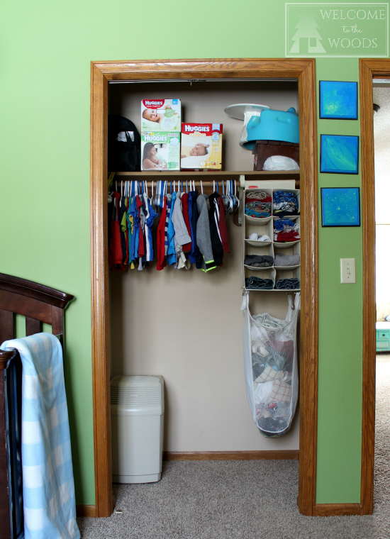 Baby clothes organized in small closet