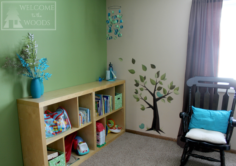 Adorable wall decal of tree and little birds for nursery decor.