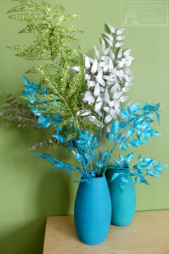 Glittery branches blue, silver, and green in turquoise vase