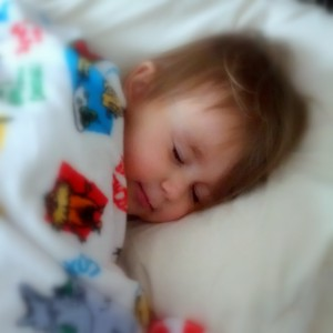 Child sleeping soundly peavefully happily