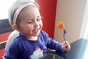 Toddler eating healthy food