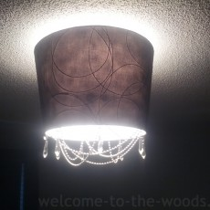 diy chandelier in master bedroom made from lamp shade