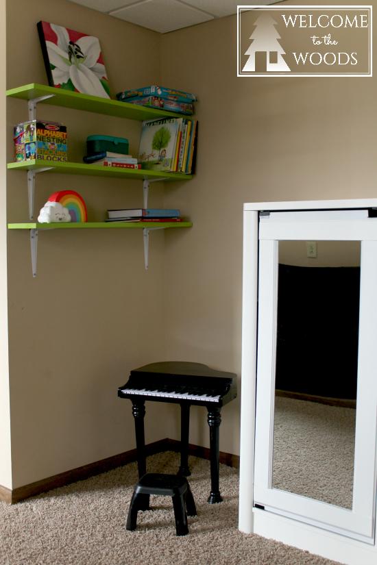 mini grand piano in a little girls bedroom