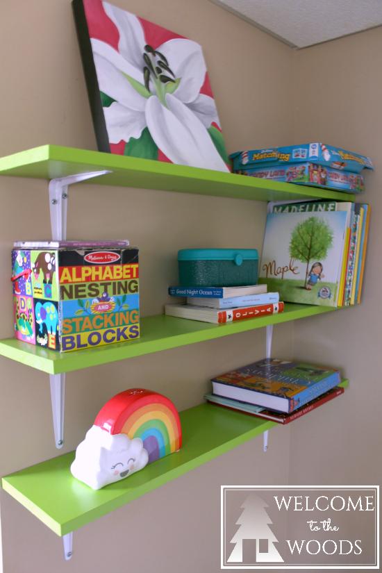 Lime green bookshelves in little girls bedroom full of children's books and kids games