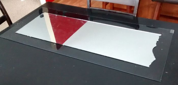 Glue mirror onto glass