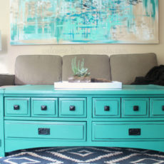 This turquoise coffee table is amazing! I love this whole living room design...