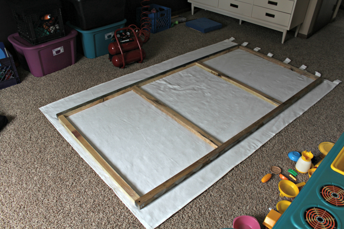 Make a large wall canvas from a white curtain panel. Includes plans on how to build the wood frame!