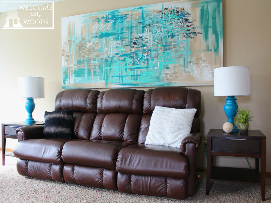How to design a living room around a big brown recliner sofa. This couch is not aesthetically pleasing, but see how I worked with it in my livingroom makeover.