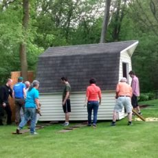 Learn how to move a shed by rolling it!