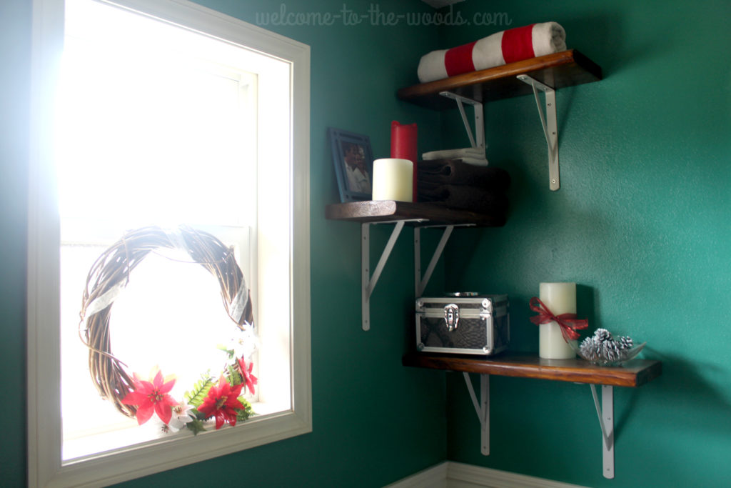 Decorating for Christmas in unusual places. The bathroom with teal, red, and white.