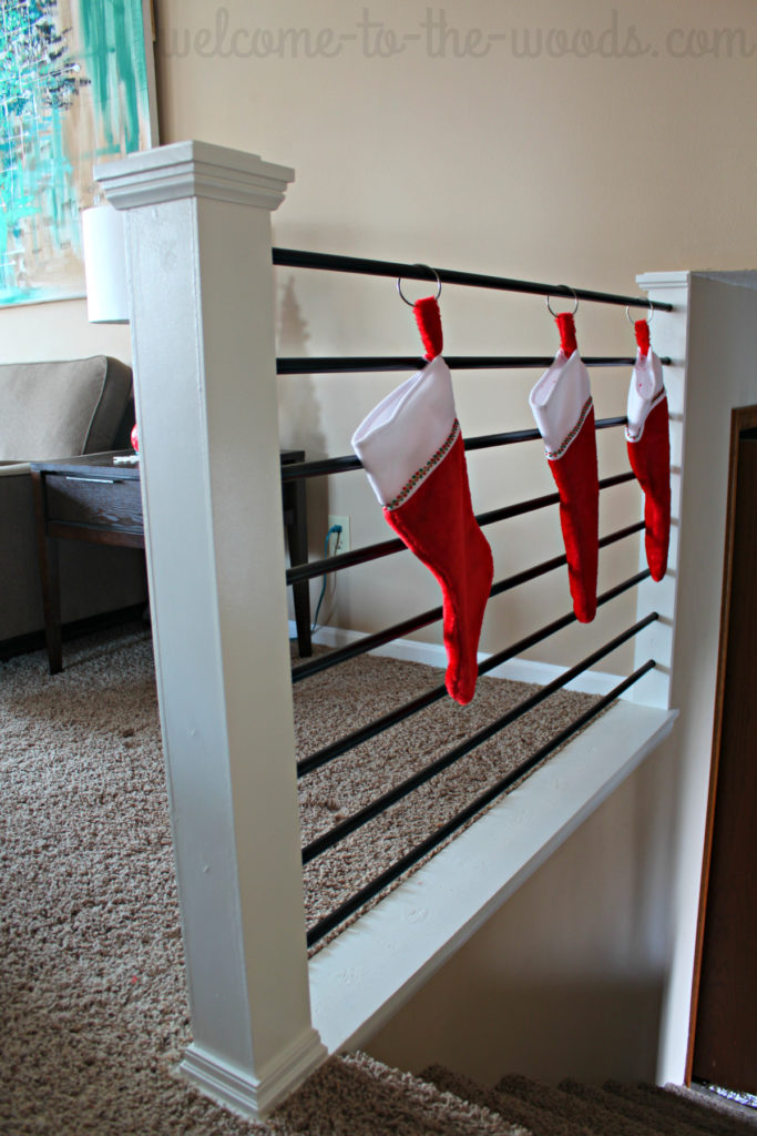 Hang your Christmas stockings on your stair railing or any bar (like a curtain rod!?) What a great idea for those homes without a fireplace!