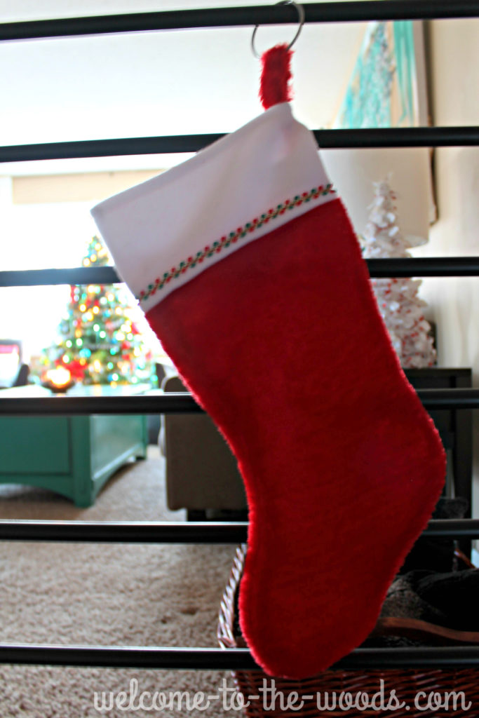Hang your stockings on your stair railing or any bar (like a curtain rod!?) What a great idea for those homes without a fireplace!