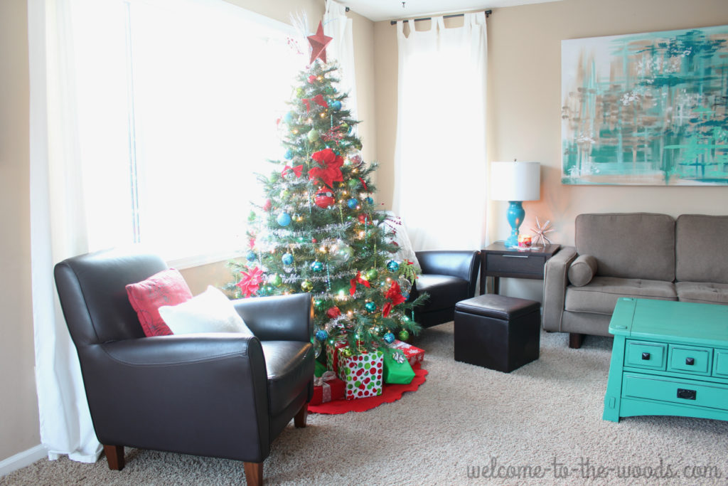 Christmas tree placement in the living room, in front of large window and between two sitting chairs. I love that it is the focal point and you can see it lit up from outside at night!
