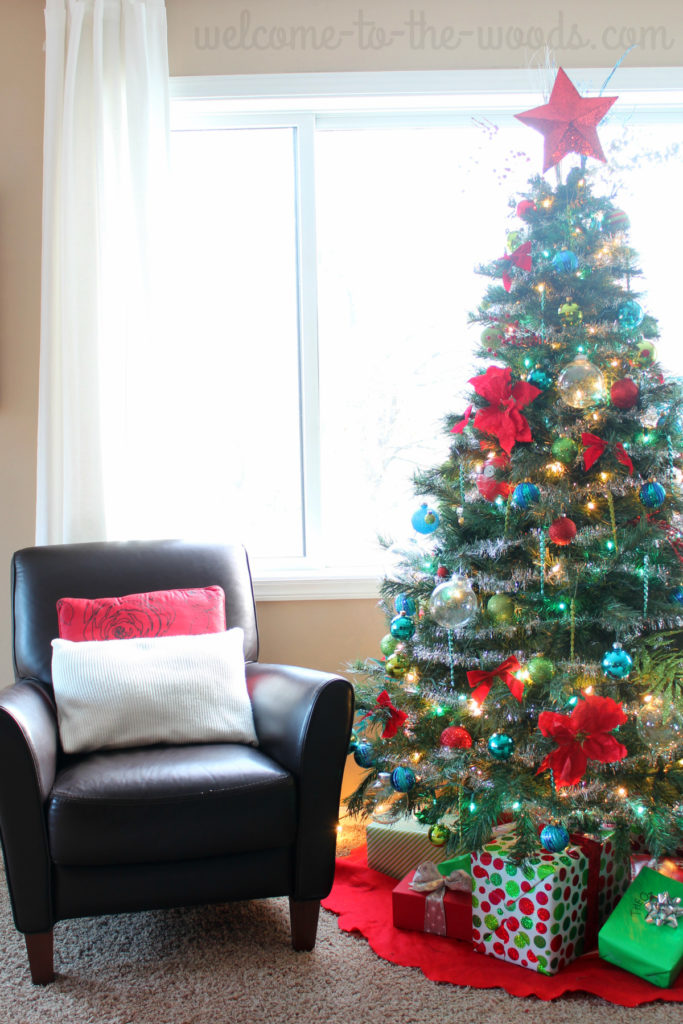 Beautiful, colorful Christmas tree in this living room holiday decor. Click to see the whole home holiday tour!
