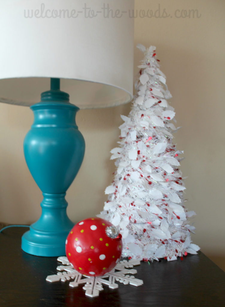 Love this white mini tree for the end table decor, the giant ornament and glitter snowflake are nice touches, too.