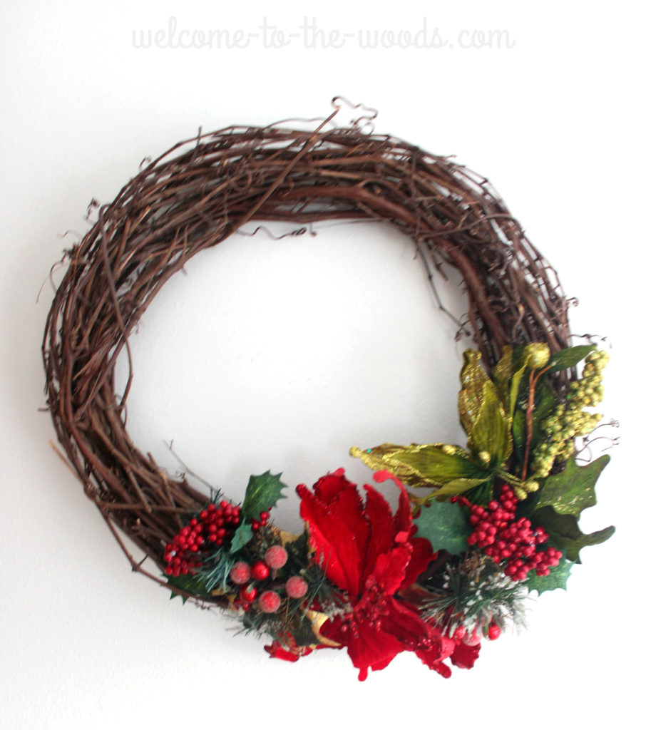 Poinsettia winter Christmas grapevine wreath, glittery branches and cranberry details.