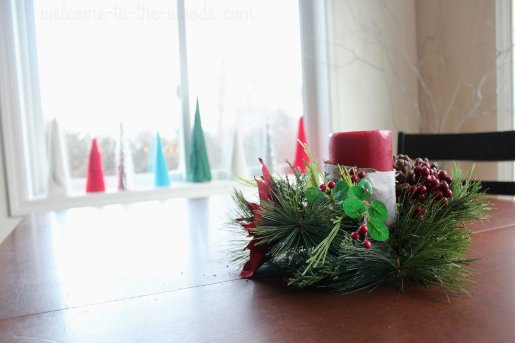 Wrap candles in birch bark for a simple Christmas centerpiece.