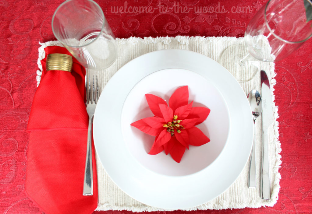 Christmas holiday tablescape in red with poinsettias.