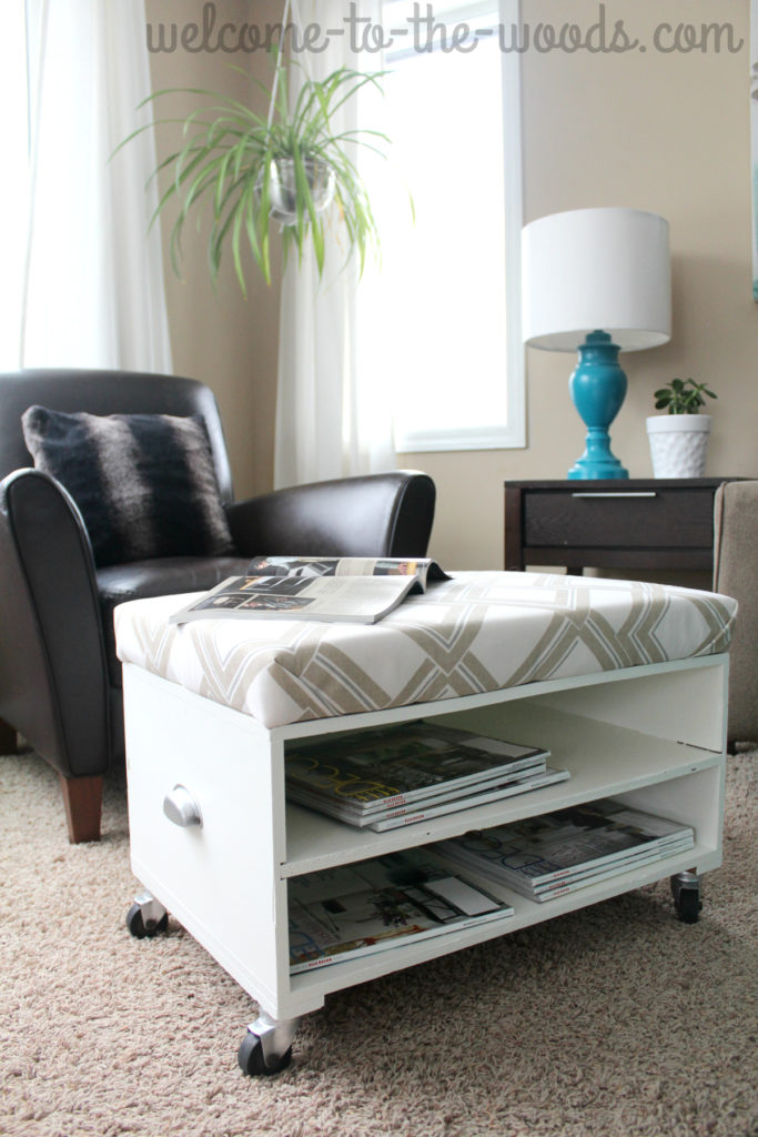 Upholster and paint a little bench to turn it into a comfortable ottoman in the living room.